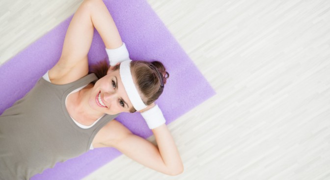 http-www-shutterstock-com-pic-103212776-stock-photo-smiling-fitness-woman-laying-on-fitness-mat_5155.jpg