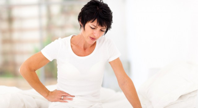 http-www-shutterstock-com-pic-128950097-stock-photo-mature-woman-sitting-on-bed-and-having-stomach-ache_ff2b.jpg