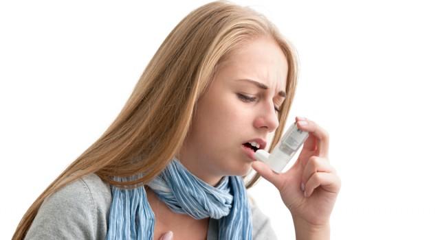 http-www-shutterstock-com-pic-151945970-stock-photo-young-woman-using-an-asthma-inhaler-as-prevention_d1c9.jpg