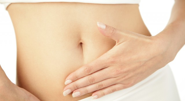 http-www-shutterstock-com-pic-31998349-stock-photo-closeup-of-young-woman-with-hand-on-her-stomach_ee0e.jpg